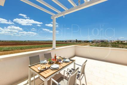 This suite has view on the coast of Torre Pali